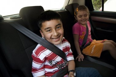 Children sitting inside a car