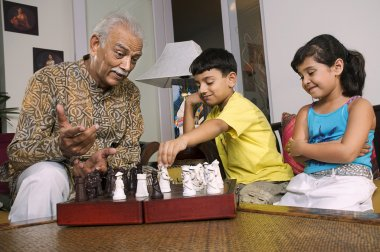 Grandfather playing with grandchildren