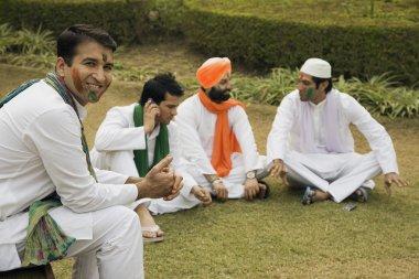 Men relaxing during Holi