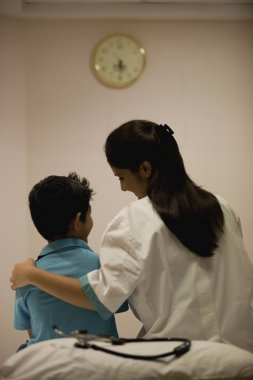 Doctor comforting her patient