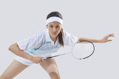 young female  playing badminton