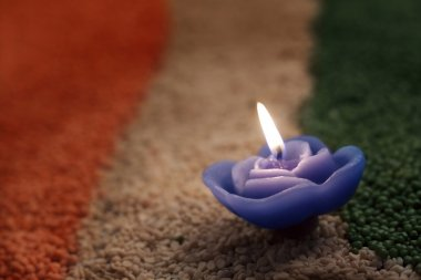Candle in the middle of coloured pulses