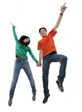 Boy and girl jumping in the air