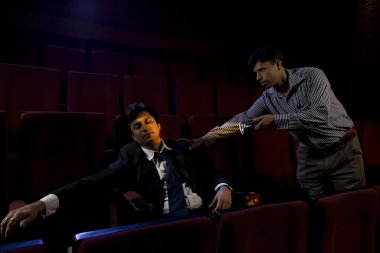 Businessman sleeping inside a cinema hall