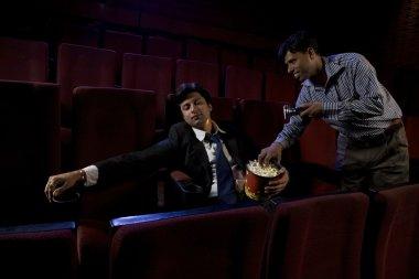 Businessman sleeping inside a cinema hall