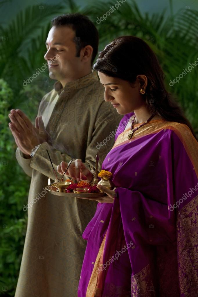 Maharashtrian couple praying