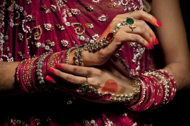 Jewelery on hands of Indian bride