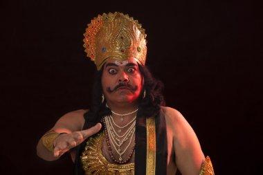 Man dressed as Raavan smiling