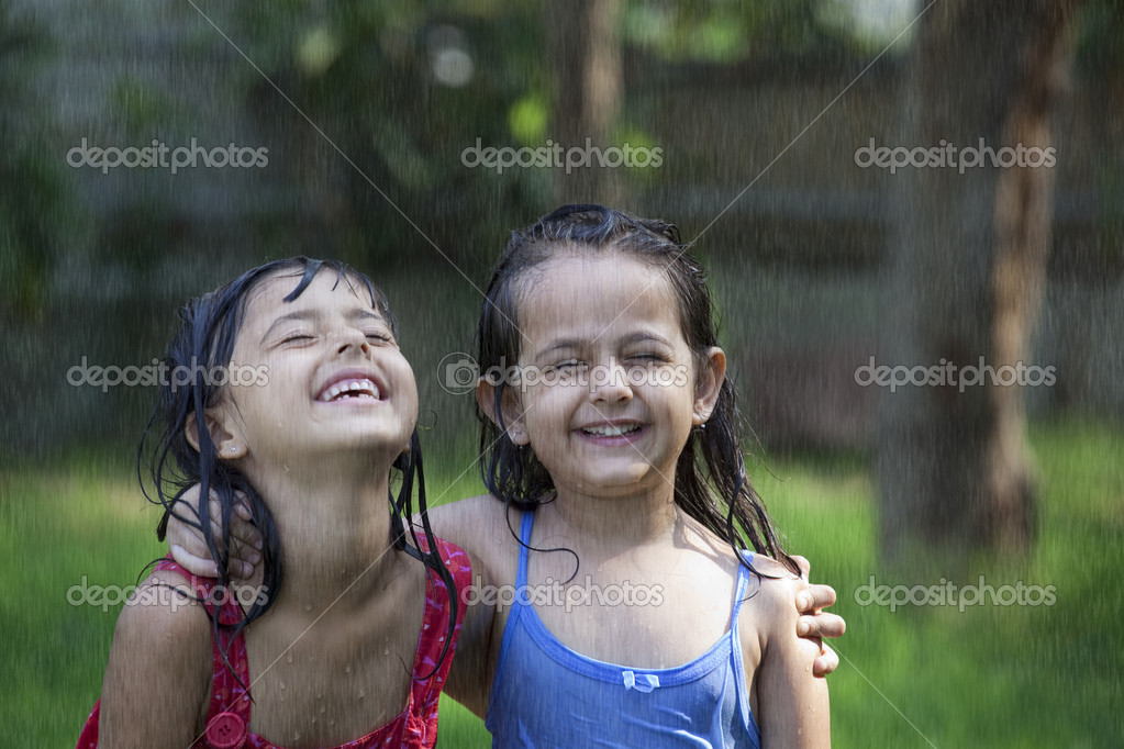 Girls standing in the rain