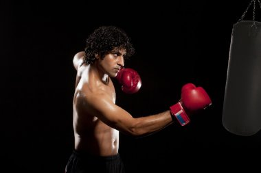 Man in boxing stance training
