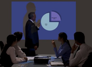 Businessman giving presentation on projection screen