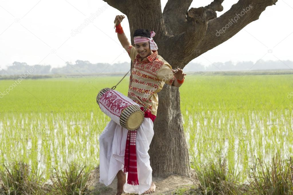 Bihu man playing on a dhol
