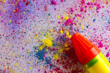 Squirt gun on colorful powder paint spread over white background stock vector