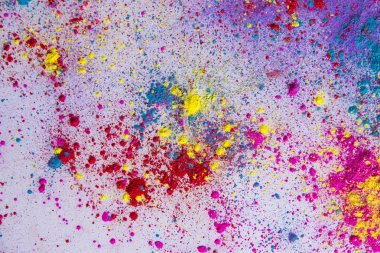 Multi-colored powder paint spread over white background stock vector