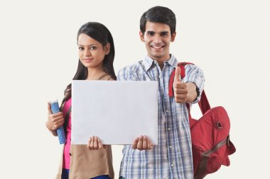 College students holding a white board