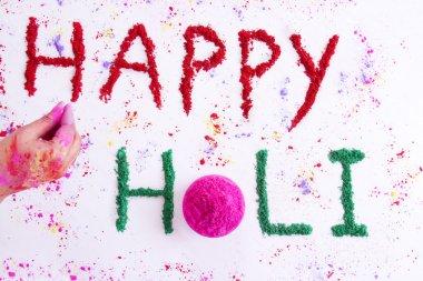 Text Happy Holi written on rangoli stock vector