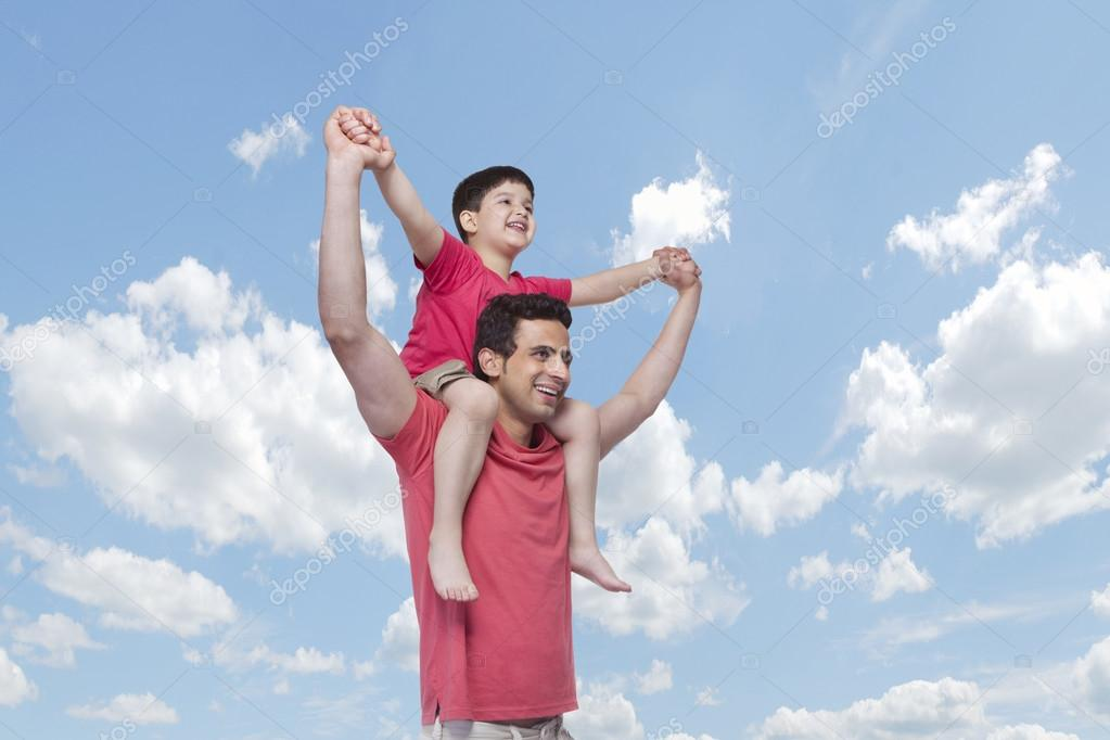 Happy father carrying son