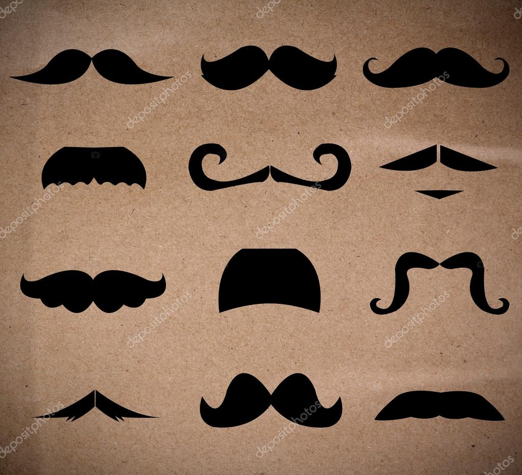 Set of mustaches isolated on recycle paper background.