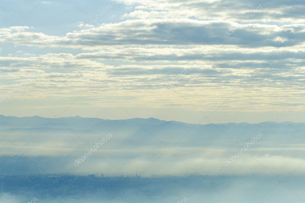 Blue Sky with mountain silhouette