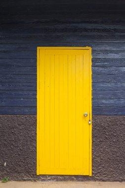 yellow door, blue wall