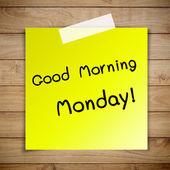 Dobré ráno na pondělí na lepící papír o hnědé dřevěné prkené zeď tex