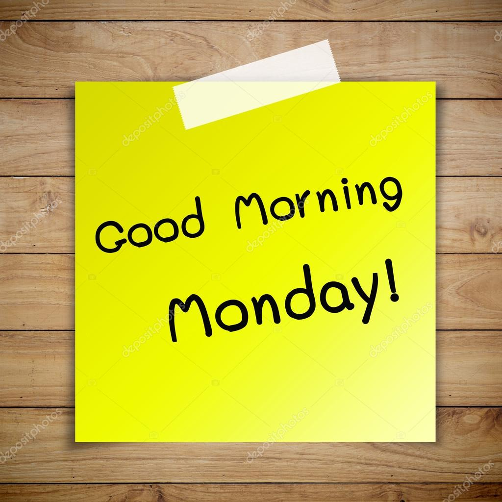 Good morning monday on sticky paper on Brown wood plank wall tex