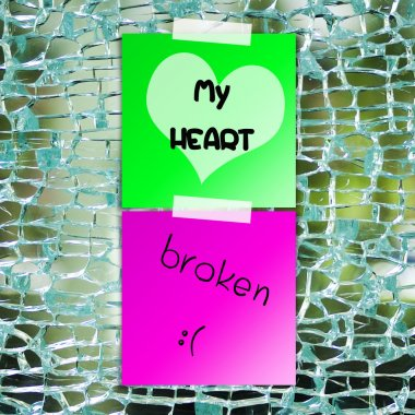Broken heart text on sticky paper with broken glass background