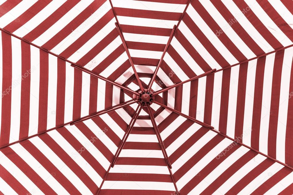 Red and white umbrella beach