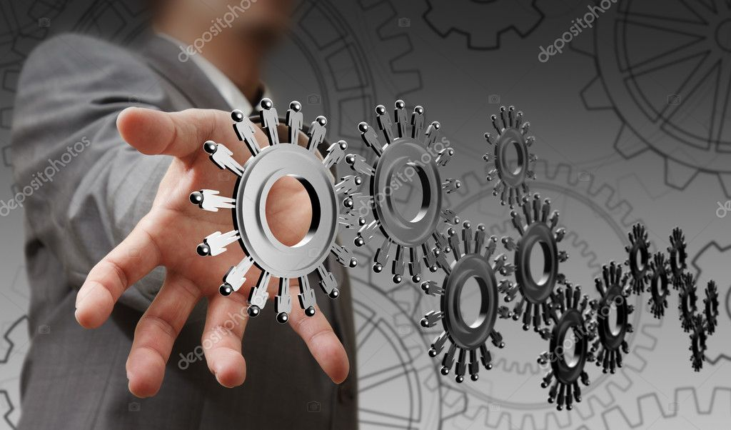 Businessman hand shows cogs