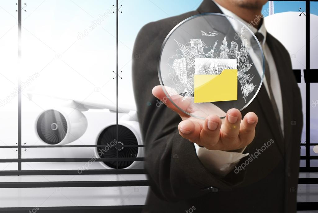 business man hand shows travel shield at the airport