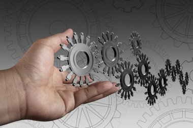 Hand shows cogs as concept