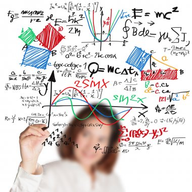 female teacher writing various high school maths and science for
