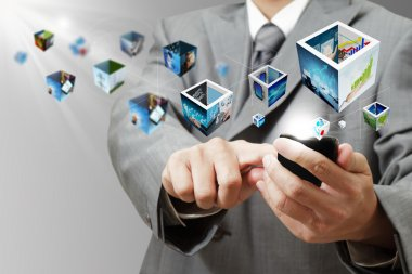 business man hand holding a touch pad computer and 3d streaming