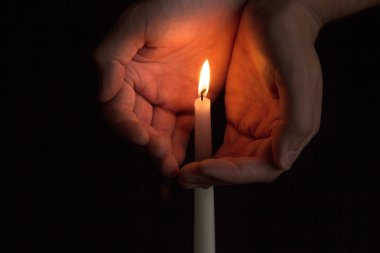 Hand near the candle