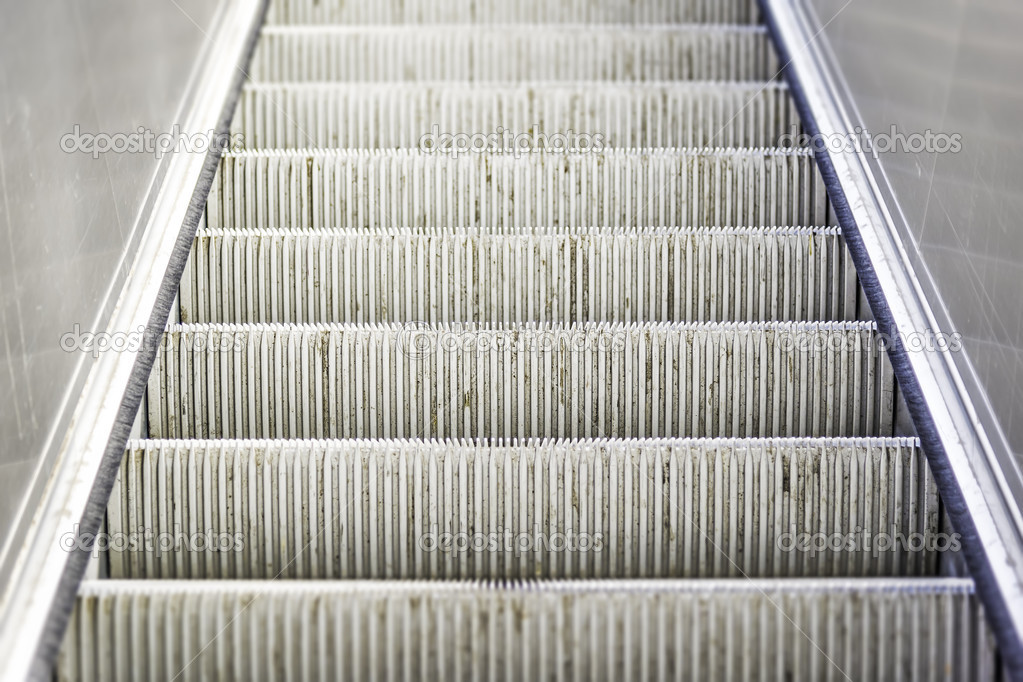 31492e1acb41 heavily used and worn escalator stairs — Stock Photo © w20er  29943203