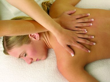 Woman relaxing in massage at spa salon