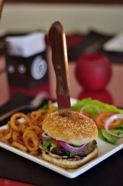 Mini hamburger with knife stock vector