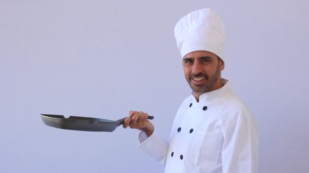 Chef toying with the pan