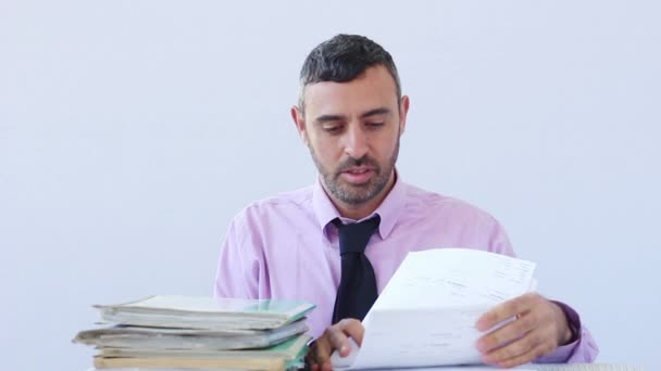 Exhausted businessman asleep at his desk