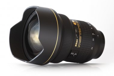 Nikkor AF-S 14-24mm 1:2.8G ED made by Nikon in Japan on white with shadow and reflection, ultra wide angle zoom lens.