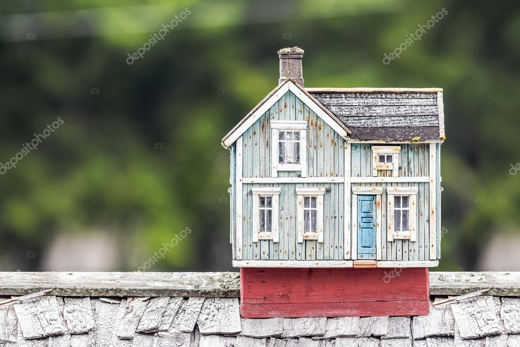Miniature house on a rooftop
