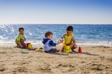 Group of Children Playing with Beach Toys