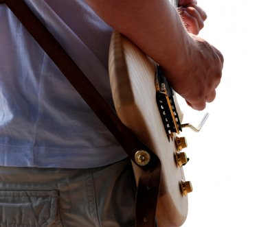 Detail of guitarist playing his guitar