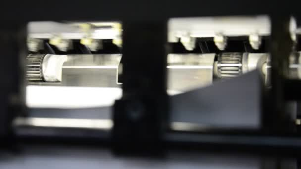 closeup of offset machine into print-shop. Final storage department of the printed material sheets at the end of machine.