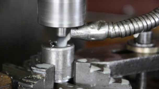 Industrial CNC drill machine milling some steel part