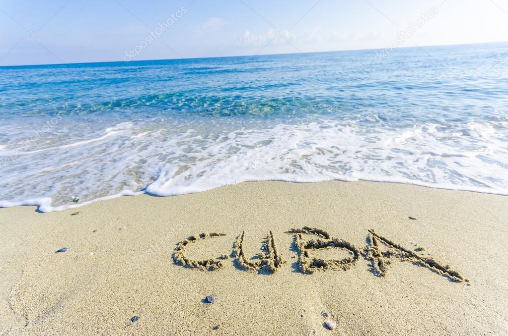 Word Cuba Drawn On The Sand Of A Beach Stock Photo