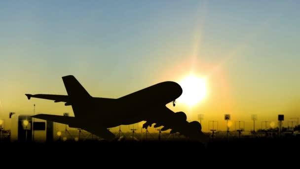 osobní letadla přistávají na soumraku