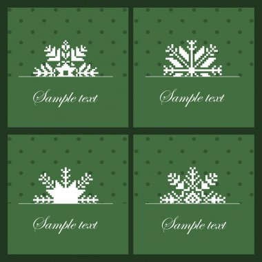 Four snowflakes on the green background