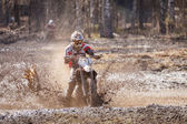 Photo Motocross driver in mud