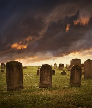 Spooky cemetery with stormy clouds for Halloween